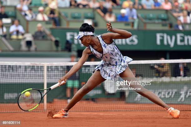 Venus Williams of the United States of America plays a backhand during her Women's single match against Elise Mertens of Belgium on day six of the...