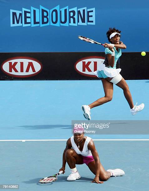 Venus Williams of the United States of America plays a backhand during her doubles with Serena Williams of the United States of America against Maret...
