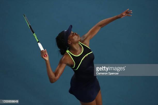 Venus Williams of the United States of America serves during her Women's Singles first round match against Coco Gauff of the United States of America...