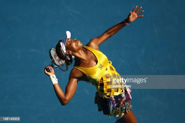 Venus Williams of the United States of America serves in her second round match against Sandra Zahlavova of the Czech Republic during day three of...