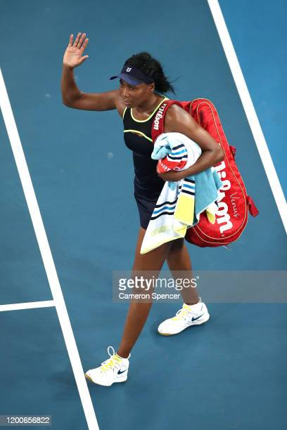 Venus Williams of the United States of America waves to the crowd after losing her Women's Singles first round match against Coco Gauff of the United...