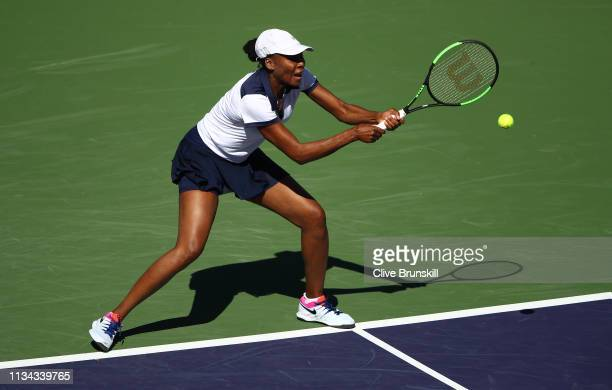 Venus Williams of the United States plays a backhand against Andrea Petkovic of Germany during their womens singles first round match on day four of...