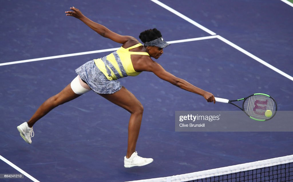 Venus Williams of the United States plays a backhand against Elena Vesnina of Russia in their quarter final match during day eleven of the BNP Paribas Open at Indian Wells Tennis Garden on March 16, 2017 in Indian Wells, California.