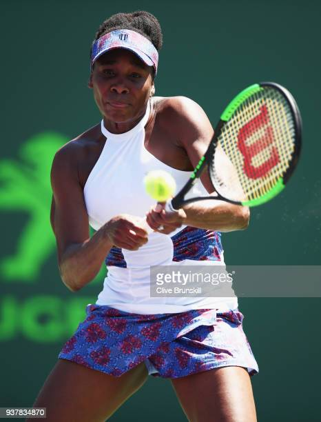 Venus Williams of the United States plays a backhand against Kiki Bertens of Belgium in their third round match during the Miami Open Presented by...