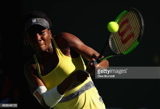Venus Williams of the United States plays a backhand against Lucie Safarova of the Czech Republic in their third round match during day eight of the...