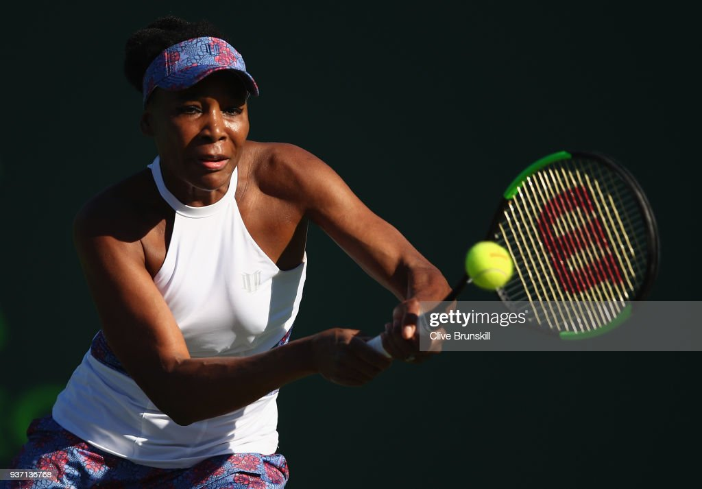 Venus Williams of the United States plays a backhand against Natalia Vikhlyantseva of Russia in their second round match during the Miami Open Presented by Itau at Crandon Park Tennis Center on March 23, 2018 in Key Biscayne, Florida.