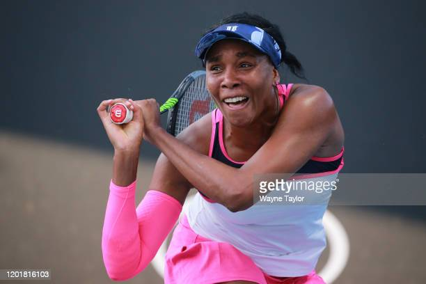 Venus Williams of the United States plays a backhand during her Mixed Doubles first round match with partner Juan Sebastian Cabal of Colombia against...