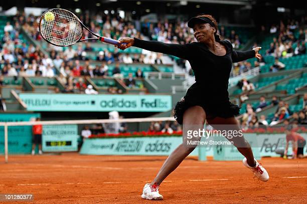 Venus Williams of the United States plays a backhand during the women's singles fourth round match between Venus Williams of the United States and...
