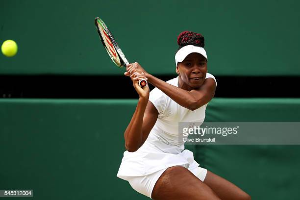 Venus Williams of The United States plays a backhand during the Ladies Singles Semi Final match against Angelique Kerber of Germany on day ten of the...