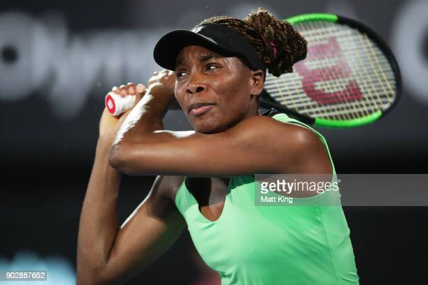 Venus Williams of the United States plays a backhand in her 1st round match against Angelique Kerber of Germany during day three of the 2018 Sydney...