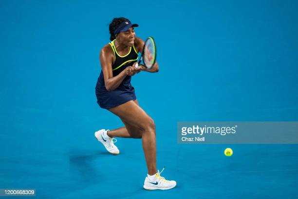 Venus Williams of the United States plays a backhand in her first round match against Coco Gauff of the United States on day one of the 2020...