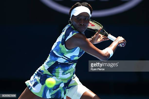 Venus Williams of the United States plays a backhand in her first round match against Johanna Konta of Great Britain during day two of the 2016...