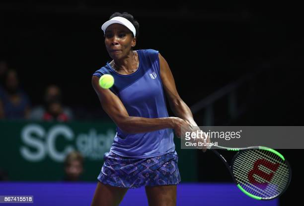 Venus Williams of the United States plays a backhand in her singles semi final match against Caroline Garcia of France during day 7 of the BNP...