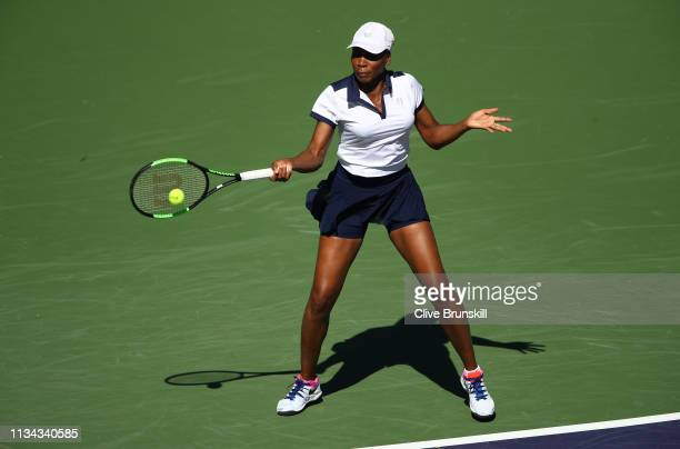 Venus Williams of the United States plays a forehand against Andrea Petkovic of Germany during their womens singles first round match on day four of...