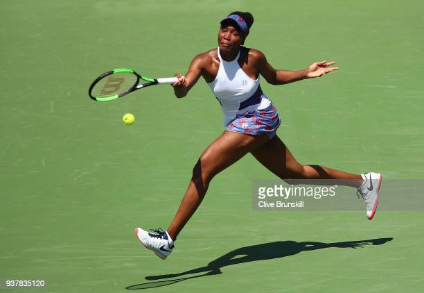 Venus Williams of the United States plays a forehand against Kiki Bertens of Belgium in their third round match during the Miami Open Presented by...