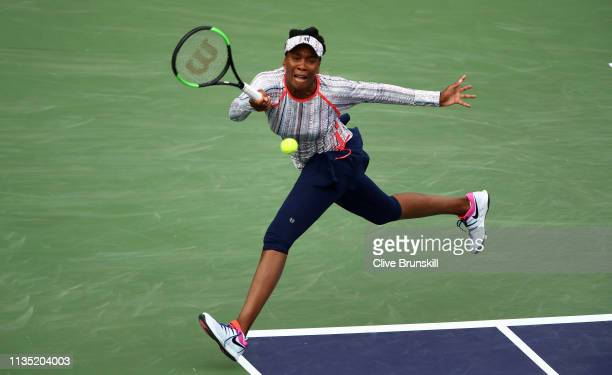 Venus Williams of the United States plays a forehand against Christina McHale of the United States during their women's singles third round match on...