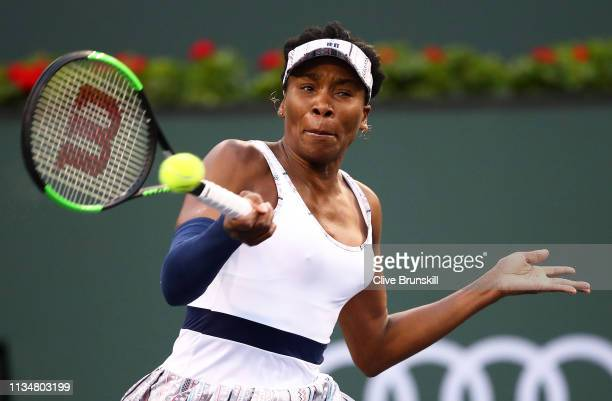 Venus Williams of the United States plays a forehand against Petra Kvitova of the Czech Republic during their women's singles second round match on...