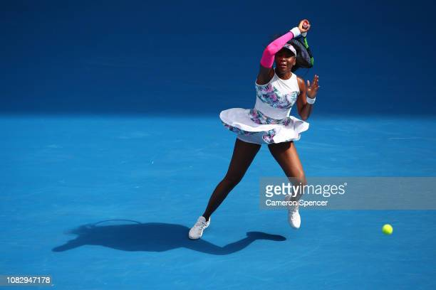 Venus Williams of the United States plays a forehand in her first round match against Mihaela Buzarnescu of Romania during day two of the 2019...