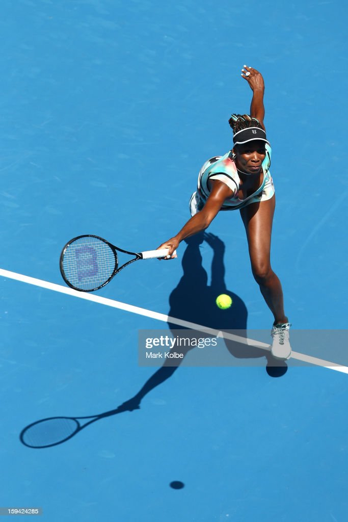 Venus Williams of the United States plays a forehand in her first round match against Galina Voskoboeva of Kazakhstan during day one of the 2013 Australian Open at Melbourne Park on January 14, 2013 in Melbourne, Australia.