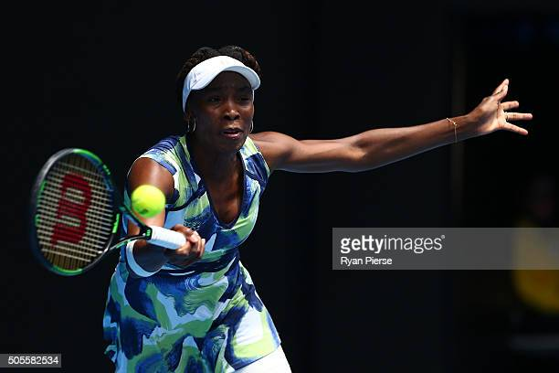 Venus Williams of the United States plays a forehand in her first round match against Johanna Konta of Great Britain during day two of the 2016...
