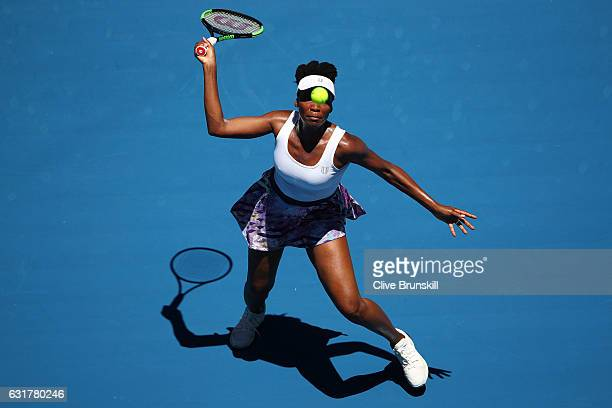Venus Williams of the United States plays a forehand in her first round match against Katerina Kozlova of the Ukraine on day one of the 2017...