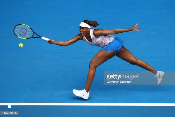 Venus Williams of the United States plays a forehand in her first round match against Belinda Bencic of Switzerland on day one of the 2018 Australian...
