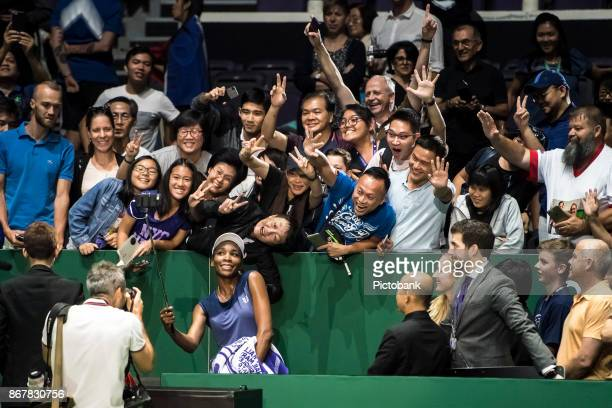 Venus Williams of the United States poses for a selfie with fans after her singles semi final match against Caroline Garcia on day 7 of the BNP...