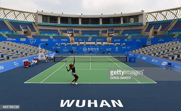 Venus Williams of the United States practices her serve on center court at the Optics Valley International Tennis Center ahead of the start of the...