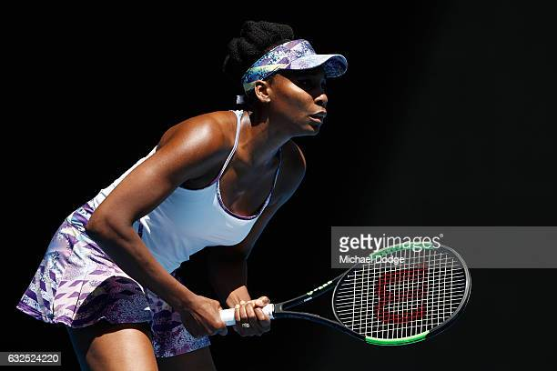 Venus Williams of the United States preapres to return serve in her quarterfinal match against Anastasia Pavlyuchenkova of Russia on day nine of the...