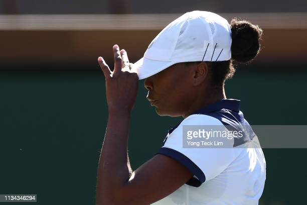 Venus Williams of the United States reacts during her women's singles first round match against Andrea Petkovic of Germany on Day 4 of the BNP...