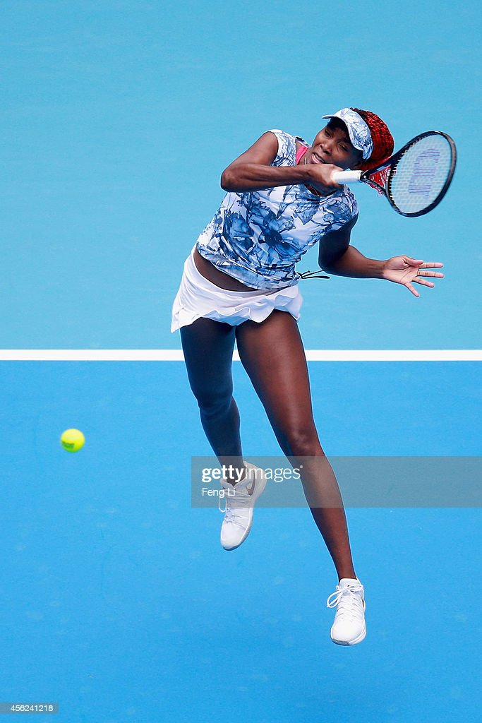 Venus Williams of the United States returns a shot against Heather Watson of Great Britain during day two of the China Open at the China National Tennis Center on September 28, 2014 in Beijing, China.