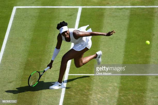 Venus Williams of the United States returns a shot against Kiki Bertens of the Netherlands during their Ladies' Singles third round match on day five...