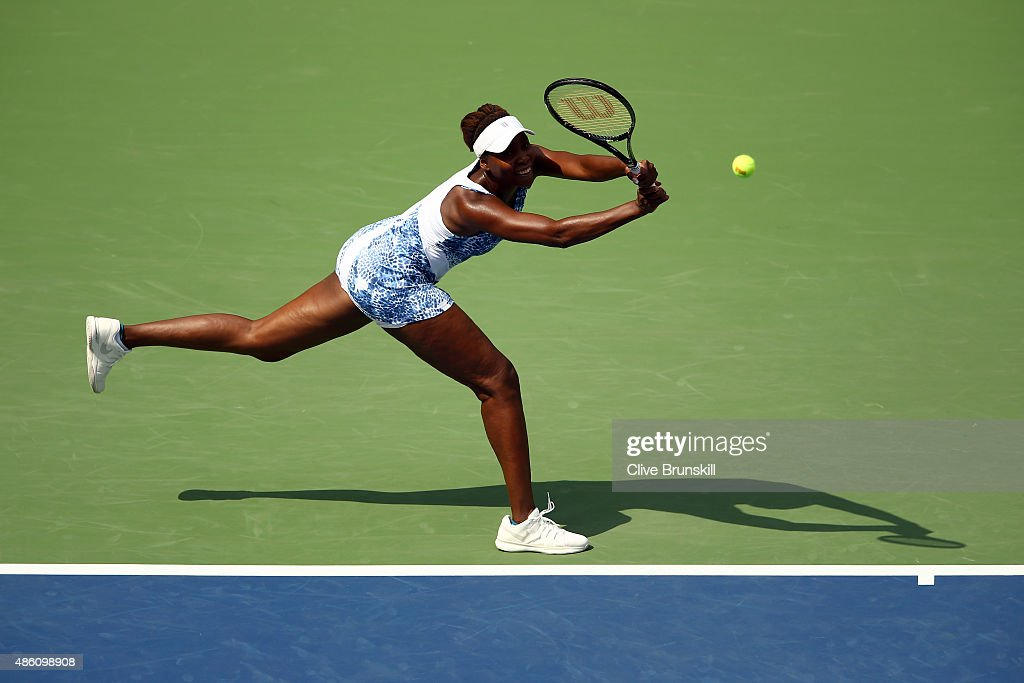 Venus Williams of the United States returns a shot against Monica Puig of Puerto Rico during her Women's Singles First Round match on Day One of the 2015 US Open at the USTA Billie Jean King National Tennis Center on August 31, 2015 in the Flushing neighborhood of the Queens borough of New York City.