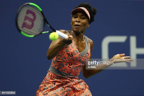 Venus Williams of the United States returns a shot against Oceane Dodin of France during their second round Women's Singles match on Day Three of the...