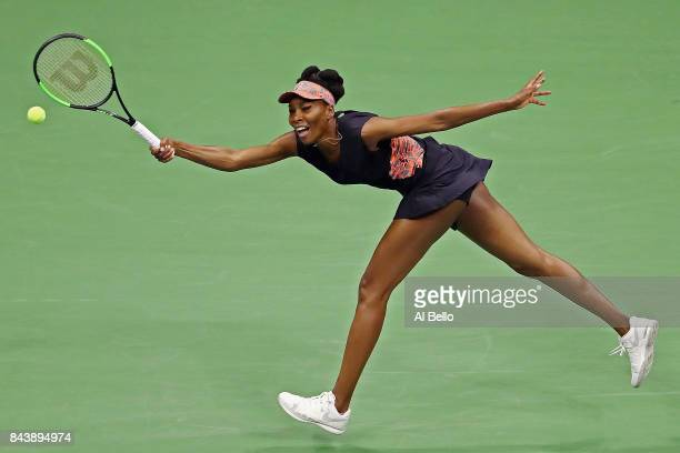 Venus Williams of the United States returns a shot against Sloane Stephens of the United States during their Women's Singles Semifinal match on Day...