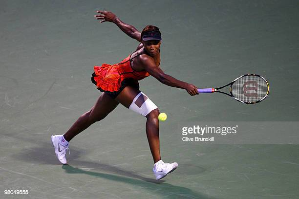 Venus Williams of the United States returns a shot against Sorana Cirstea of Romania during day three of the 2010 Sony Ericsson Open at Crandon Park...