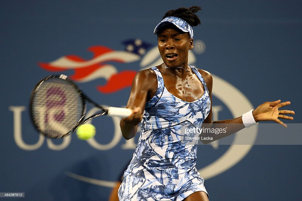 Venus Williams of the United States returns a shot against Timea Bacsinszky of Switzerland during their women's singles secound round match on Day Three of the 2014 US Open at the USTA Billie Jean King National Tennis Center on August 27, 2014 in the Flushing neighborhood of the Queens borough of New York City.