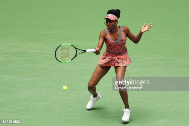Venus Williams of the United States returns a shot during her first round Women's Single match against Viktoria Kuzmova of Slovakia on Day One of the...