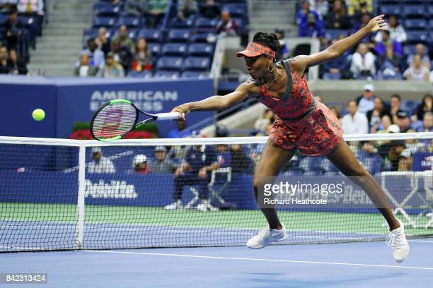 Venus Williams of the United States returns a shot during her women's singles fourth round match against Carla Suarez Navarro of Spain on Day Seven...