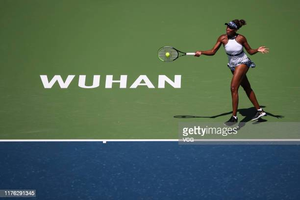Venus Williams of the United States returns a shot in the first round match against Danielle Collins of the United States on Day one of 2019 Dongfeng...