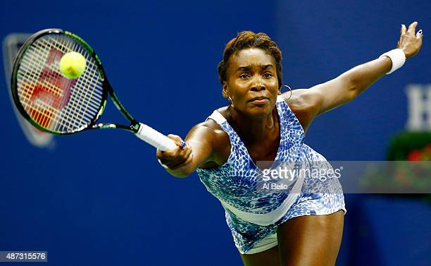 Venus Williams of the United States returns a shot to Serena Williams of the United States during their Women's Singles Quarterfinals Round match on...