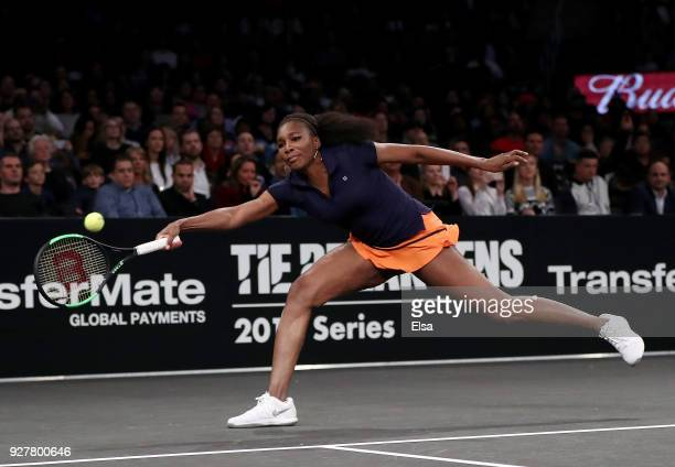 Venus Williams of the United States returns a shot to Shuai Zhang of China during the Tie Break Tens at Madison Square Garden on March 5 2018 in New...