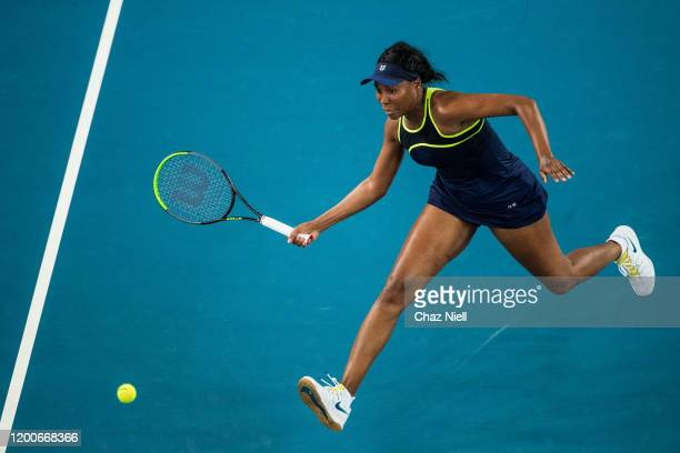 Venus Williams of the United States runs down a ball at the net in her first round match against Coco Gauff of the United States on day one of the...