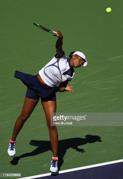 Venus Williams of the United States serves against Andrea Petkovic of Germany during their womens singles first round match on day four of the BNP...
