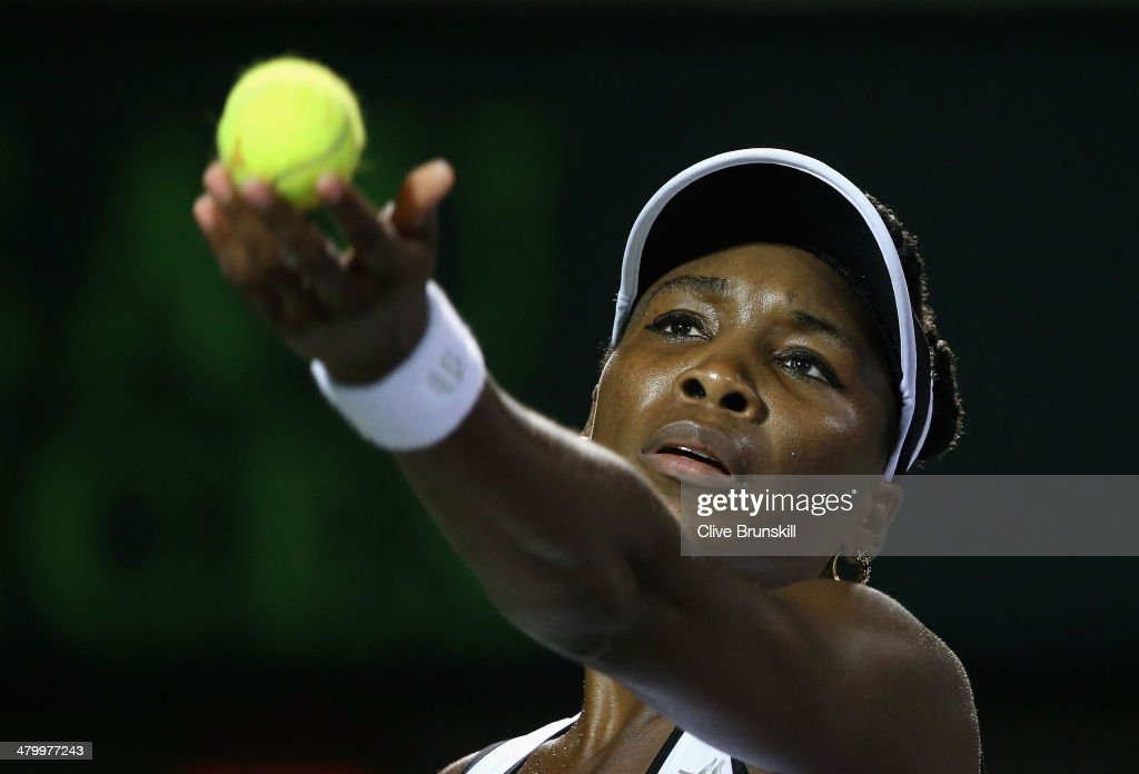 Venus Williams of the United States serves against Anna Schmedlova of Slovakia during their second round match during day 5 at the Sony Open at Crandon Park Tennis Center on March 21, 2014 in Key Biscayne, Florida.
