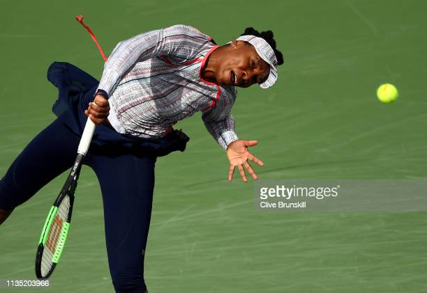 Venus Williams of the United States serves against Christina McHale of the United States during their women's singles third round match on day eight...