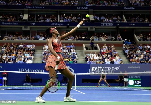 Venus Williams of the United States serves against Petra Kvitova of Czech Republic during her Women's Singles Quarterfinal match on Day Nine of the...