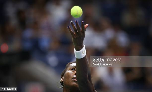 Venus Williams of the United States serves against Serena Williams of the United States during their Women's Singles Quarterfinals match on Day Nine...