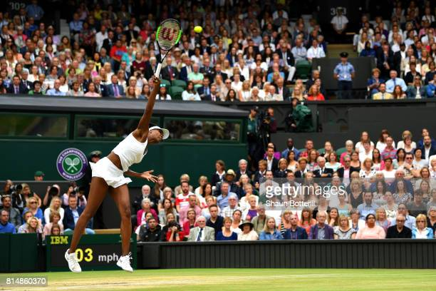 Venus Williams of The United States serves during the Ladies Singles final against Garbine Muguruza of Spain on day twelve of the Wimbledon Lawn...