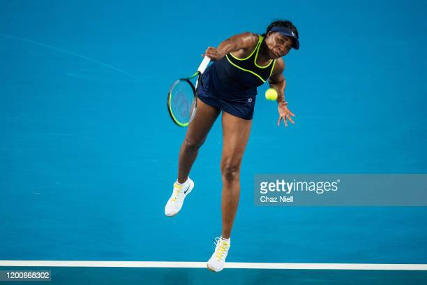 Venus Williams of the United States serves in her first round match against Coco Gauff of the United States on day one of the 2020 Australian Open at...
